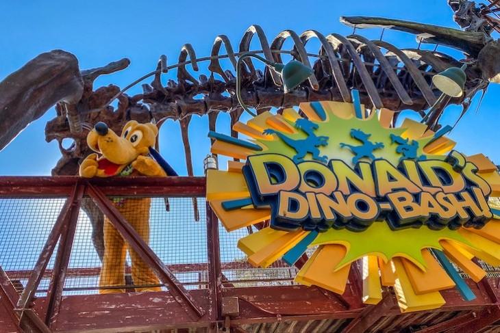 Pluto greeting guests at DinoLand