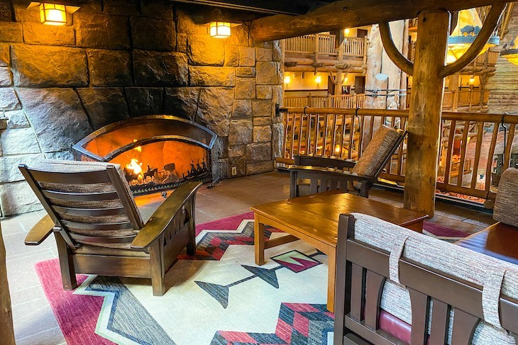 Cozy alcove seating around the fireplace can be found just off the lobby