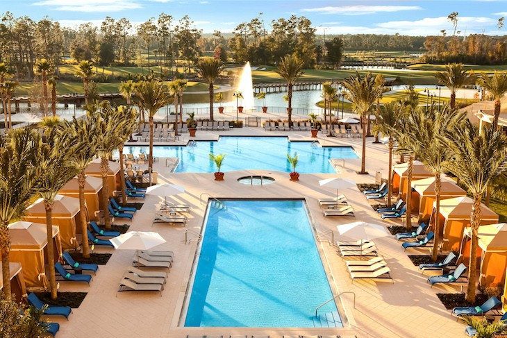 Pool area with its classic style and the golf course in the distance